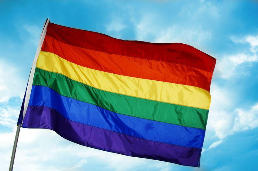 6062171 - a rainbow flag on a sky blue